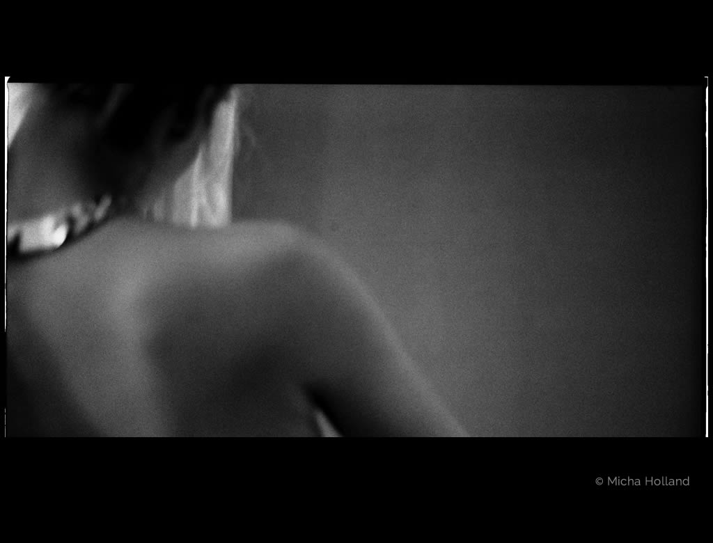 Naked shoulder by Micha Holland. The black-and-white photo shows Cate Martin's naked shoulder from a very close angle.