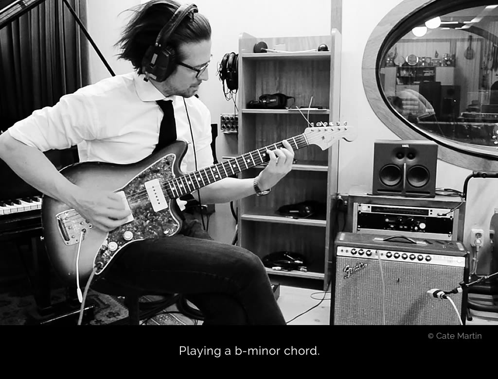 Micha Holland in the recording room at Tambourine Studios playing a vintage Fender Jazzmaster, tracking guitars for the album Young And Pretty by Ivy Flindt.