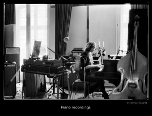 A moody black-and-white photo showing graceful Cate Martin playing on a Malmsjö grand piano for the album recordings of Young And Pretty by Ivy Flindt.